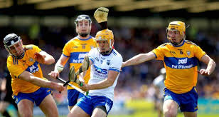 waterford s peter hogan is challenged by cathal malone and colm galvin of clare during the munster