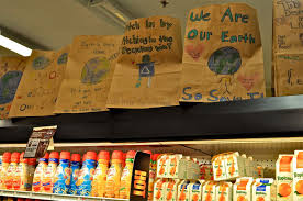 wit s end earth day in honor of earth day members of the local 6th grade class decorate brown paper grocery bags pictures around a theme they select about which they