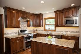 light toned granite counter tops porcelain back splash tile and accent tile with glass and stone add stylish finishing touches to this traditional kitchen