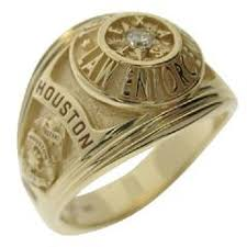 a custom houston police sergeant s professional ring in 14k yellow gold with a 0 08 ct