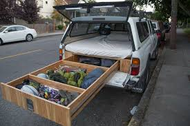 what this guy put in the back of his truck made me so jealous this is genius truck storagediy storage bedvan