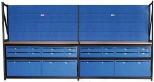 metal workbench with drawers. this unit has four, four drawer lockable tool storage units, two long workbenches, displays with 50 hooks and maxi-drawers. metal workbench drawers