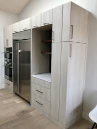 Revolve Design Build Rise Grey Wood Veneer Cabinets With Stainless Steel