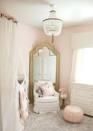 crystal chandelier for nursery a kids crystal beaded chandelier illuminates a whimsical pink and gray girls