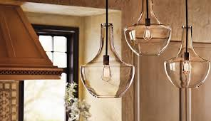 the design of these generous pendants from kichler s everly collection is based on decorative blown glass containers sporting a classic lamp base shape