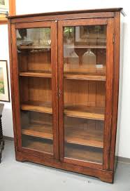 wood farmhouse barn door bookcase attractive found in mission oak gl door bookcase sold regarding wood bookcases with doors ideas world market wood