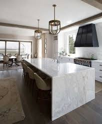 enjoy the durability of marble using it not only for a waterfall countertop but also for
