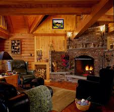 log home den with brick fireplace