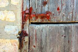 An Zoomed In Crop Of An Old Wooden Barn Door With A Red Latch ...
