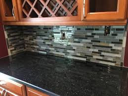 florida tile for backsplash kitchen ideas with floating wood cabinets and black granite countertop plus wood