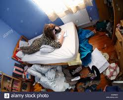 Messy Teenage Bedrooms A Teenage Girls Messy Untidy Bedroom With Handwriting All Over