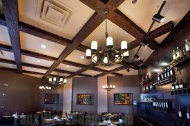 hanging lights installed on a restaurant s beams