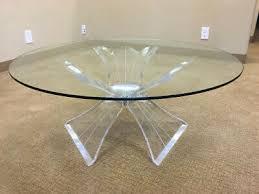lucite coffee table in the style of