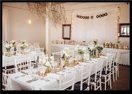 white tiffany chairs, white table cloths, gold table runners Wedding Linen Brisbane Wedding Linen Brisbane #13 Wedding Centerpieces