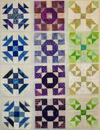 Kathy's Quilts & And here are all my blocks for the Squared Away quilt along on the design  wall. I am making 4 blocks each month. My blocks are 5
