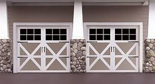 barn door garage doorsCarriage house style garage doors httpwwwwaynedaltoncom