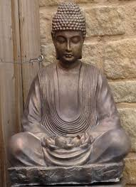 buddha statue on ornate plinth