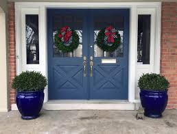 since i love a painted door i decided to paint my front doors a steely blue even when it gets a bit gray in winter the blue doors add a bright spot