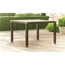 brown jordan form  in square patio dining table  stock