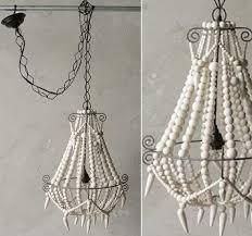 iron and wood bead chandelier