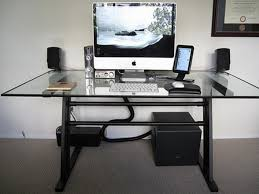 modern glass top computer desk design with white keyboard and