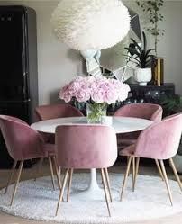 dining table room pink velvet chairs and dark furniture