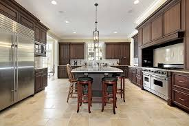 custom kitchen designs. large custom kitchen with dark brown cabinets, stainless steel appliances (with extra refrigerator designs
