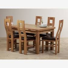 oak furniture land dorset natural solid oak extending solid oak round dining table and 6 chairs