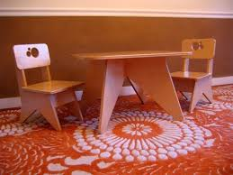 origami table and chair set with red rugs