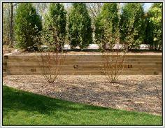 Small Picture How to Build a Timber Retaining Wall To build a timber supporting