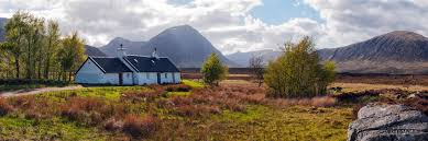 A panoramic view of the Blackrock Cottage with Buchaille Etive Mor in the  background, near