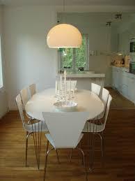 white kartell fly over dining table