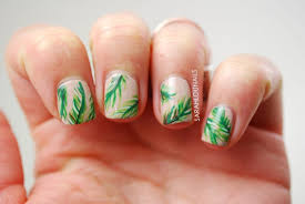 you can paint green palm leaves on your white nails to have palm leaf nails this is a bit diffe palm tree nail designs