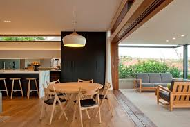 dining room pendant lighting. wood pendant light dining room contemporary with gray upholstered cushions transom windows black leather seat chair lighting