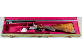 A 12 bore side by side shotgun by Wesley Richards, Serial No. 10049, 30ins  blued steel barrels wi