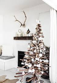 Driftwood Christmas tree decorated with coastal ornaments