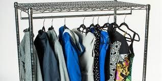 spotlight clothes hanging on a garment rack
