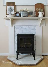 wood stove mantel creating a life diy faux mantel update use with lion heads