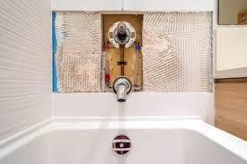 gluing bathroom tiles back