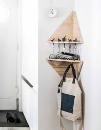 Triangle corner shelves Wood Small Triangle Shelves For Keys And For Hanging Bags And Backpacks Are Ideal For Entryway Shelterness 15 Comfy Corner Shelves To Save Some Space Shelterness