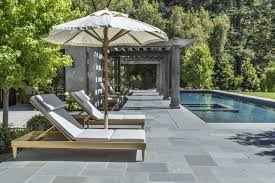 a pool surround laid in an ashlar pattern in marin county california
