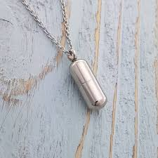 silver pill shaped container vial