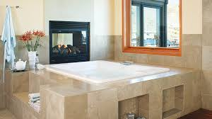 deck mounted jetted tub with fireplace