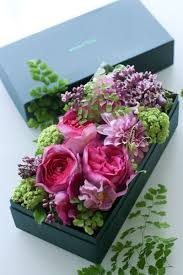 flowers arranged in a box, love this idea using cauliflower tinted light  green in color