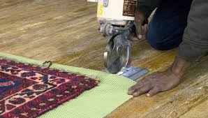 photo of padding being cut for an area rug