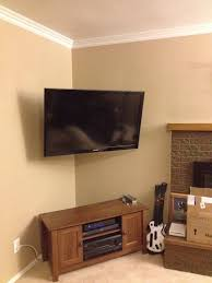 Corner mounted TV with the wires hidden adds so much space in your bedroom  and gives