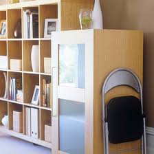 office storage ideas. home office wood shelving and foldaway chair storage ideas