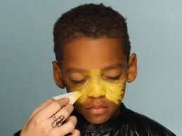 apply yellow face paint