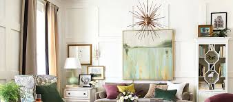 chandelier with drum shade hanging over dining table ballard designs