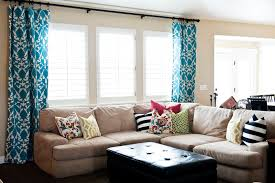 ... Living Room Window Treatments With Blue Curtain And Sofa And Cushion  And Black ...